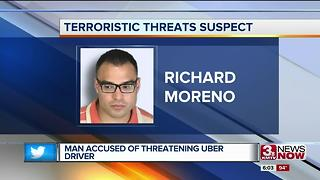 Man allegedly says he'd cut Uber driver's throat - Video