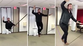 Office daredevils set up slackline at work