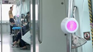 South Korea helps pregnant women get seats on trains - Video
