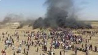 Drone Video Shows Burning Tires as Protesters Gather at Gaza Borders - Video