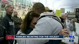 Hugs, kisses and reunions at Denver International Airport on Christmas Eve