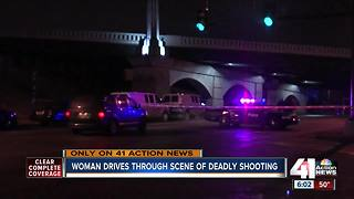 Man shot, killed, woman drives through scene - Video