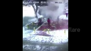 Schoolgirl submerged by snow falling from tree - Video