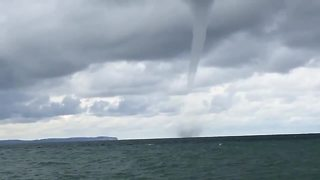 Couple on honeymoon captures waterspout on Lake Michigan - Video