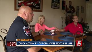 Police Officer Saves Man's Life After Crash - Video