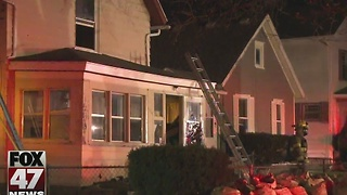 Home suffers minor damage after overnight fire in Lansing - Video