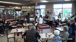 Talented Young Musicians Pull Off Christmas Flash Mob At Coffee Shop - Video
