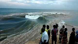 Spectators Observe As River Mixes With Sea In Tamil Nadu