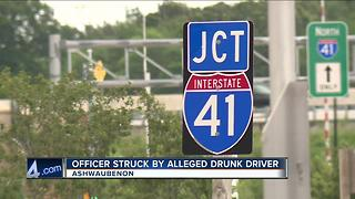 Officer hit by alleged drunk driver while assisting on a crash on I-41 - Video