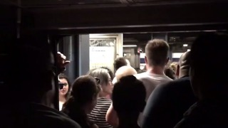 NYC Commuters Stuck for Hour on Powerless, Sweltering Subway Train - Video