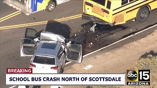 Two people injured after a car collided with a school bus near north Scottsdale