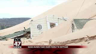 Lake Michigan sand dune threatens to cover another cottage - Video