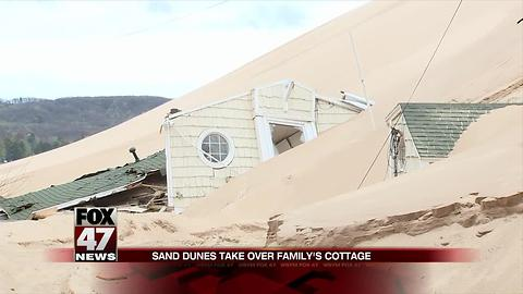 Lake Michigan sand dune threatens to cover another cottage