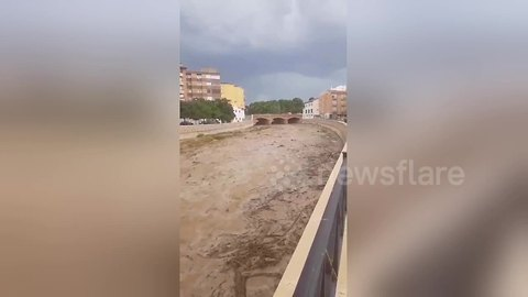 Overflowing river transports tonnes of debris following heavy rainstorm in southern Spain
