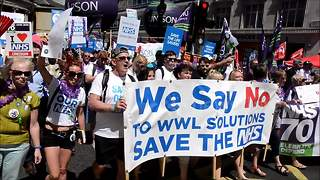 Mass protests against NHS cuts as service turns 70 - Video