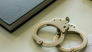Woman arrested for turning in abusive husband's guns