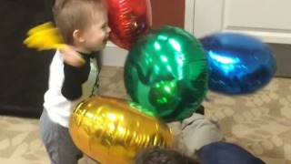 Toddler super excited to bang around balloons!  - Video