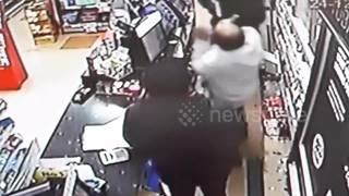 CCTV shows hero shopkeeper using karate skills to disarm gunman - Video