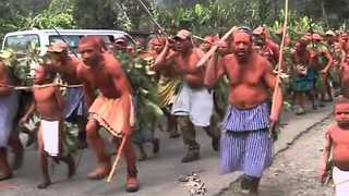 Papua New Guinea Tribe Commemorates the Dead With Tribal War Dance - Video