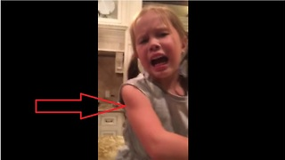 Little girl gets freaked out by ladybug - Video