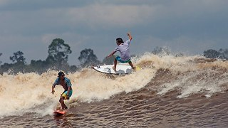 Surfer's Paradise! 30 Mile Waves Hit River In Indonesia - Video