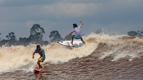 Surfer's Paradise! 30 Mile Waves Hit River In Indonesia