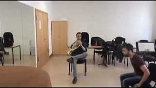 Guys Make Beautiful Music Using French Horn and a Chair - Video