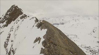 Daredevil risks life climbing mountain peak - Video