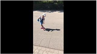 Little girl tries to run away from her own shadow