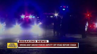 Wrong-way driver forces deputy off road before crash - Video