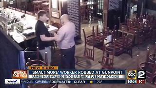 Smaltimore employee robbed at gunpoint - Video