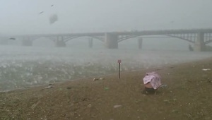 Beach-goers run for cover during freak hail storm in Russia - Video