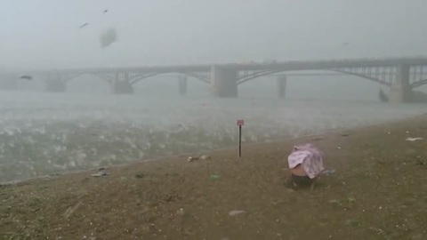 Beach-goers run for cover during freak hail storm in Russia