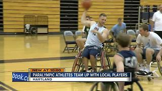 Paralympic athletes team up with local players - Video