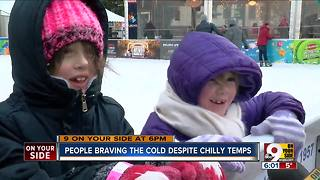 People braving the cold despite chilly temps - Video