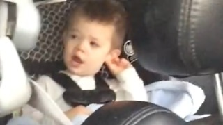 2 year old boy with the sweetest voice singing in the back seat  - Video