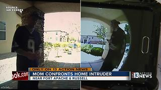 Mom confronts home intruder in front of children