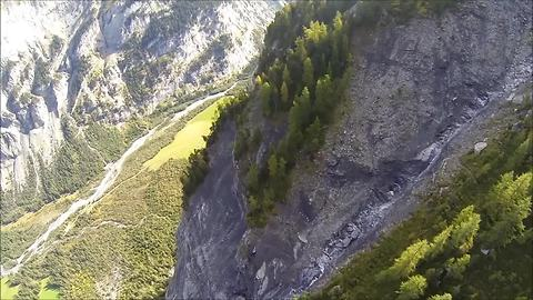 Intense BASE jump footage over stunning terrain