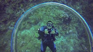 Diver demonstrates lost art of bubble rings