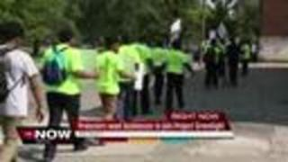 Protestors march for Project Greenlight - Video