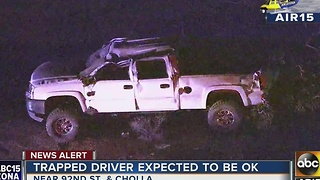 A person is hospitalized after being trapped in car after Scottsdale rollover crash