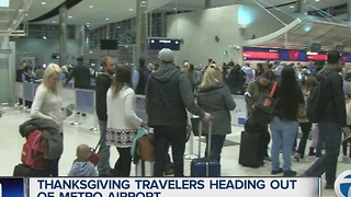 Travelers heading out of Metro Airport for Thanksgiving - Video