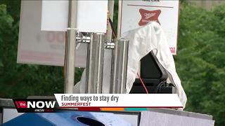 Patrons find ways to stay dry during soggy Summerfest opener - Video