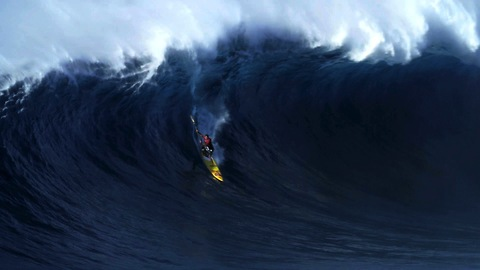 Surfers Test Their Mettle Against 12 Metre Hawaiian Waves