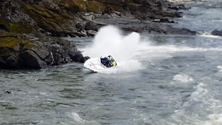 Terrifying moment speed boat crashes into rocks and flips upside down forcing passengers to escape