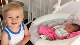Toddler learns to love her new baby sister  - Video
