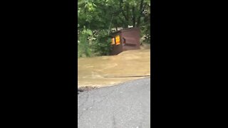 Runaway dumpster floats downstream as as result of Hurricane Isaias