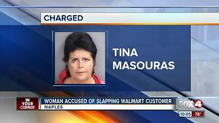 Woman accused of slapping Walmart Customer - Video