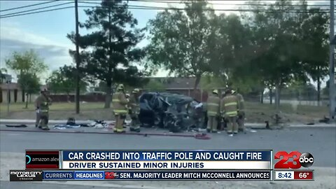 Car crashes into traffic pole, catches fire in East Bakersfield