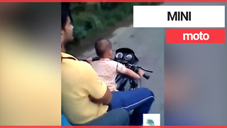 Toddler filmed riding a motorbike on a public road